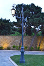 Lamppost in a park in the evening Stock Images