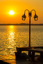 Lamppost with river and sunset Royalty Free Stock Photo