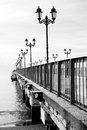 Lamps on pier black and white scenic view of lamp lights Royalty Free Stock Photo