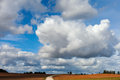 Land road and sky big clouds over in autumn time latvia Stock Photos