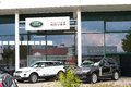 Land rover dealership with copy space Stock Photo