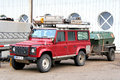 Land rover defender tatarstan russia august red off road car at the camping Royalty Free Stock Photo