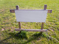 Land for sale in a meadow there is a sign building house building site a new home Royalty Free Stock Photography