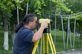 Land surveyor measuring with digital level device Royalty Free Stock Photography