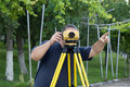 Land surveyor measuring with digital level device Royalty Free Stock Images