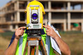 Land surveyor theodolite looking through at construction site Stock Image