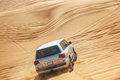 Landcruiser in desert safari driving up a sand dune Stock Image