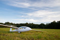 Landed sailplane white on ground Royalty Free Stock Photo