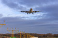 Landing aircraft over landing lights Royalty Free Stock Photo