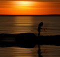 Landing net in sunset girl with beautiful the is glowing by sunlight Stock Photo