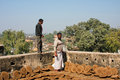 Landlord looking at pancakes dried manure madhya pradesh india of small indian town on the roof of old house in chitracoot Royalty Free Stock Photography