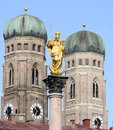Landmarks of munich the golden sculpture saint mary and the church our lady frauenkirche Stock Photography