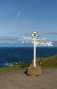 Lands end cornwall england uk signpost blue sea and sky at the most westerly point of on the penwith peninsula eight miles from Royalty Free Stock Photo
