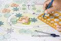 Landscape Architect Designs Blueprints For Resort. Royalty Free Stock Photo