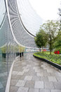 Landscape architecture a modern concept of with gardens pavements and modern glass buildings Stock Photo