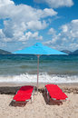 Landscape with  beach and parasols Stock Photos