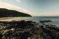 Landscape is beautiful sea and rocky beach. Green hill on ocean coast