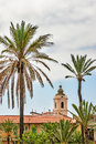 Landscape belltower palms tile roofs Royalty Free Stock Photography