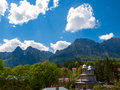 Landscape in busteni city romania a church surrounded by mountains and blue sky Stock Images