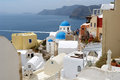 Landscape with church on santorini island and blue sea in greece Royalty Free Stock Images