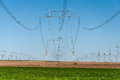 Landscape and electric power line green field blue sky Stock Photos