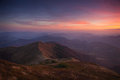 Landscape evening autumn mountains at sunset. A look from the top of the hills. Royalty Free Stock Photo