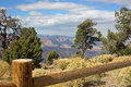 Landscape with a fence and Grand Canyon in the bac Stock Photos