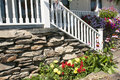 Landscape flowers and porch steps white railing on the of a country home Royalty Free Stock Photography