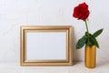 Landscape gold frame mockup with red rose in vase Royalty Free Stock Photo