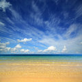 Landscape with gold sand beach and clouds Royalty Free Stock Photo