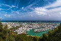 Landscape with green trees and sailing and pleasure boats harbour on background Royalty Free Stock Photo