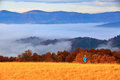 Landscape with high mountains, grey thick fog and sky. Royalty Free Stock Photo