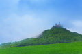 Landscape and hohenzollern castle in haze during summer time germany Royalty Free Stock Photo