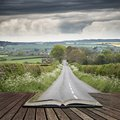 Landscape image of empty road in English countryside with dramat Royalty Free Stock Photo
