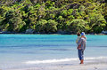 Landscape of karikari peninsula new zealand man hold his child on rangiputa beach in northland it s a famous holiday travel Stock Photo