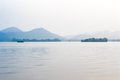 Landscape with the lake, boat, pagoda and mountains. Royalty Free Stock Photo
