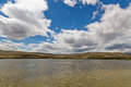 Landscape lake steppe clouds the altai with a or semi desert mountains at the horizon cloudy blue sky and with wavy water surface Stock Photography