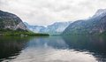 Landscape lakeside and snowy mountains at the cloudy day panorama Royalty Free Stock Images