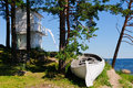 Landscape lighthouse boat beach kaesmu estonia Royalty Free Stock Photos
