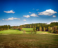 Landscape with meadows and trees hdr blue sky Royalty Free Stock Image
