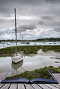 Landscape of moody evening sky over low tide marine Creative con Royalty Free Stock Photo