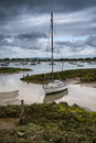 Landscape of moody evening sky over low tide marine Royalty Free Stock Photo