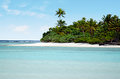 Landscape of of motukitiu island in aitutaki lagoon cook islands view from the sea Royalty Free Stock Image