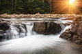 Landscape of mountain river in sunshine. View of the stony rapids. Royalty Free Stock Photo