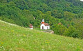 Landscape of mountain slope with white country church, Serbia Royalty Free Stock Photo
