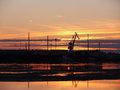 The landscape of the northern nature sunset over the river nady nadym construction on bank nadym Stock Image