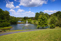 Landscape northern virginia regional park view of a public in with lush green grounds water ponds and walking trail under blue sky Royalty Free Stock Photos