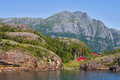 Landscape in norway a red house near the fjord Royalty Free Stock Images