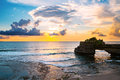 Landscape, Ocean in sunset with cliff and natural arch at Tanah lot, Bali Royalty Free Stock Photo