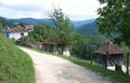 Landscape of an old mountain village road serbia summer with traditional country architecture Stock Photo